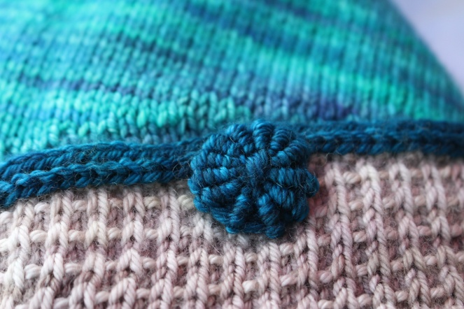 I can't wait to knit a beanie and sew a button like this on top!